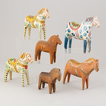 A set of six Swedish painted  carved wooden horses, 20th Century.