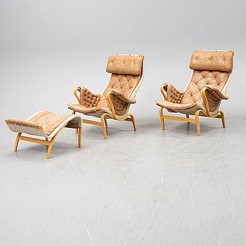 Bruno Mathsson, a pair of 'Pernilla' armchairs and a stool, Dux.