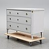 A painted gustavian style chest of drawers.