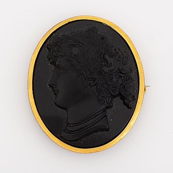 Brooch, with carved black stone cameo.