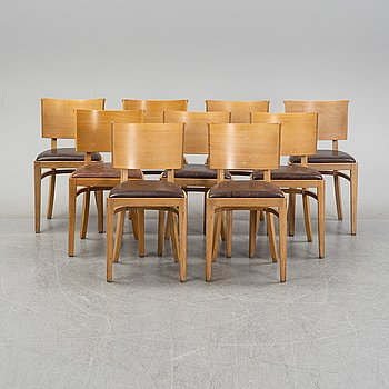 A set of nine oak veneered chairs, end of the 20th Century.