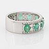 Emerald and brilliant cut diamond ring.