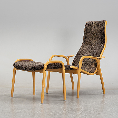 A 'lamino' easy chair and stool by yngve ekström for swedese, designed 1957.