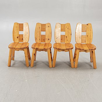 A set of four 1970s pine chairs.