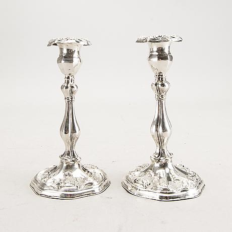 A 19th century pair of silver candle sticks mark of oskar närman mariestad 1877.