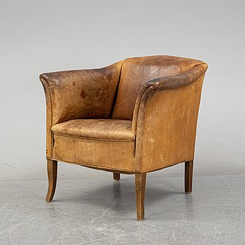A leather club chair, mid 20th century.