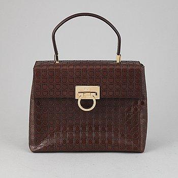 Salvatore Ferragamo, a brown, embossed leather handbag.