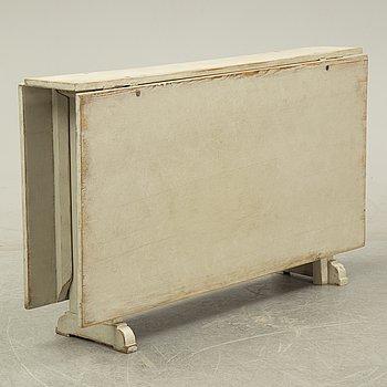 A mid 19th Century gate-legged table.