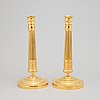 A pair of french empire candlesticks, first half of the 19th century.