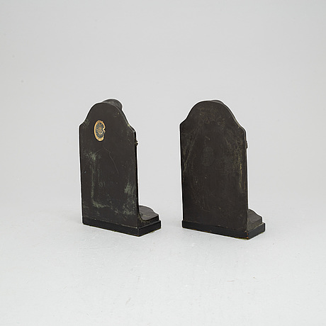 Azel gute, a pair of bronze bookends, signed and dated 1920.
