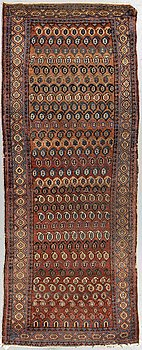 A runner, semi-antique West persian, ca 252 x 100 cm.
