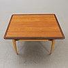 A 1950/60s teak and oak coffee table.