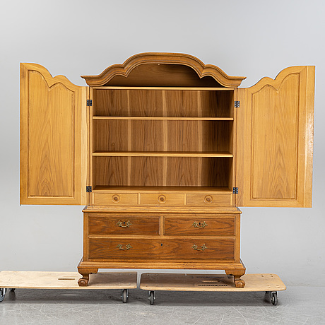 A 20th century baroque style cabinet.