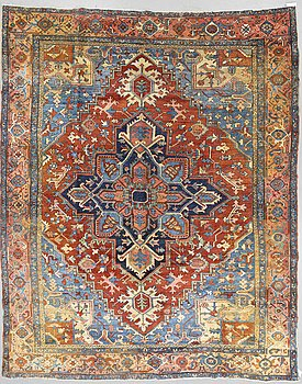 A carpet, Antique Heriz, ca 375 x 305 cm.