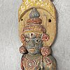 A wooden sculpture of a diety, south east asia, 20th century.