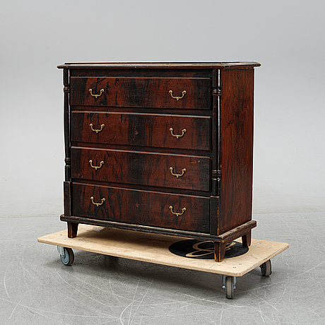 A painted chest of drawers from around the year 1900.