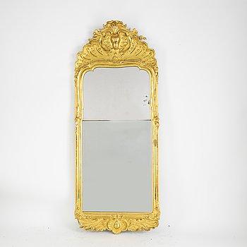 A rococo mirror, 18th Century.