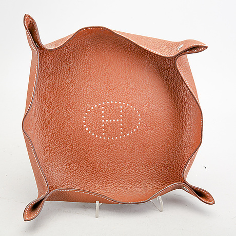 """Hermès, a set of two leather and felt """"change trays""""."""