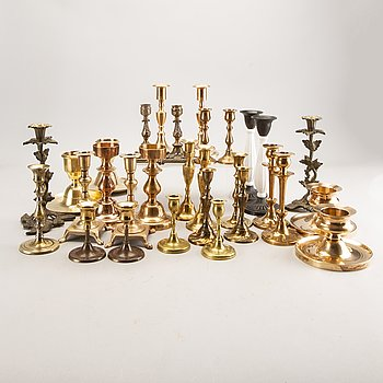 A set of 15 pair of candle sticks.