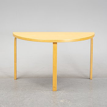 Alvar Aalto, a birch veneered table, Artek, Finland, 1992.