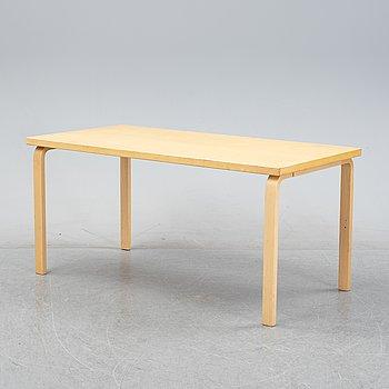 Alvar Aalto, a birch veneered table, Artek, Finland, 1990.