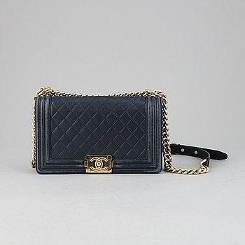 Chanel, a navy leather 'Boy Bag' 2017-18.