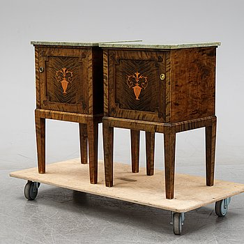 A pair of stained birch bedside tables, first half of the 20th Century.
