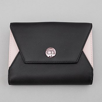 Christian Dior, a black and mink leather wallet.