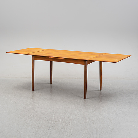 A mid 20th century teak veneered dining table, denmark.
