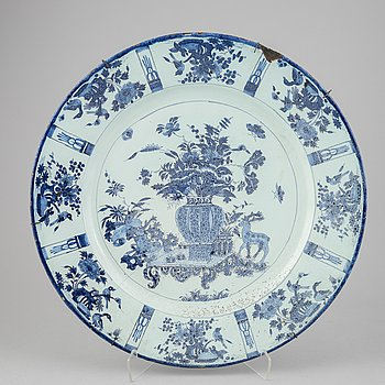 A large faience dish, 18th Century.