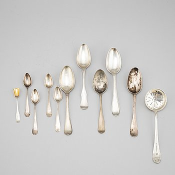 A set of eleven silver cutlery, 18-19th Century.