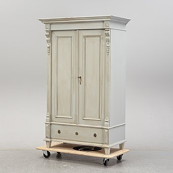 A Gustavian style painted cabinet, around the year 1900.