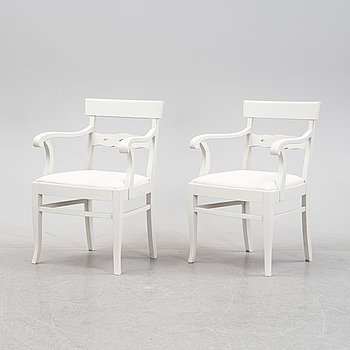 A pair of painted chairs, first half of the 20th Century.