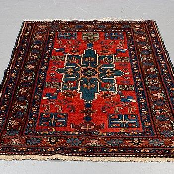 A carpet, semi-antique North west persian, ca 222 x 180 cm.