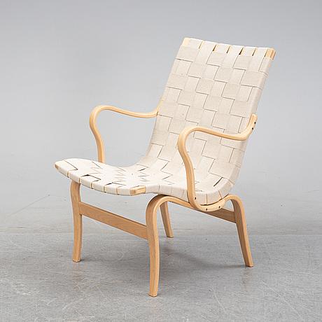 An 'eva' lounge chair by bruno mathsson for mathsson international, dated 2020.
