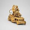 A louis xvi-style ormolu and parcel gilt mantel clock, mid 19th century.