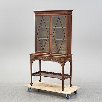 A mahogany vitrine cabinet, fromaround the year 1900.