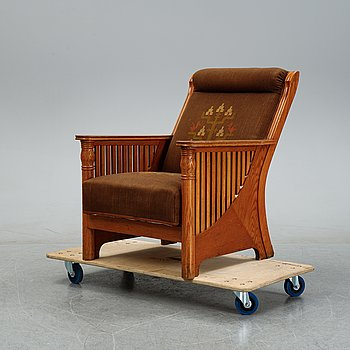 A Jugend oak armchair, early 20th century.
