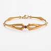 A 14k gold and amethyst bracelet. kalevala koru, helsinki 2000.