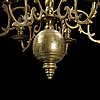 A brass baroque style chandelier from around the year 1900.
