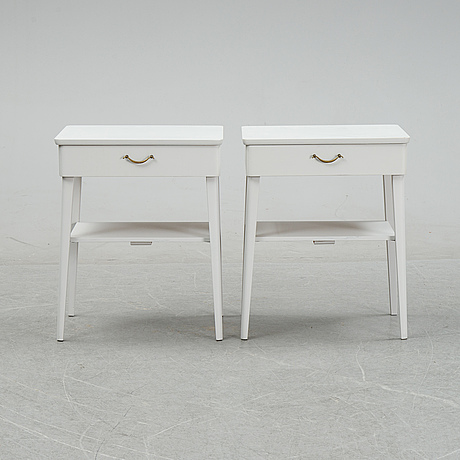 A pair of mid 20th century bedside tables.