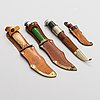 A set of four puukko knives and leather sheats, marked olympia helsinki -52.