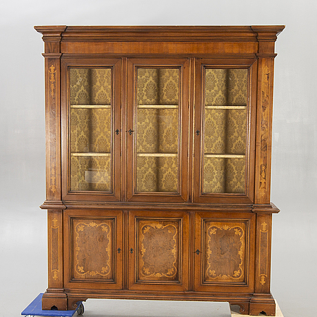 A mahogany and walnut display cabinet later part of the 20th century.