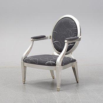 A contemporary Louis XVI style armchair.