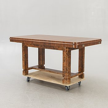 An Art Deco 1940s walnut dining table.