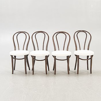 A set of four early 1900s chairs.