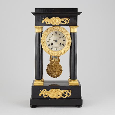 A mid 19th century mantel clock.