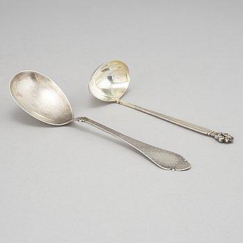 Johan Rohde, an 'Acorn' sterling sauce ladle, Georg Jensen post 1945 + a Danish silver serving spoon, Copenhagen 1931.