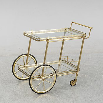 A glass and brass drinks trolley.