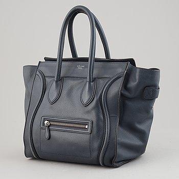 Céline, a teal leather 'Luggage' handbag.